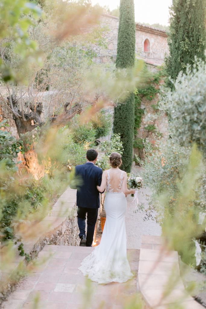 Lea and Mehdi walking down in their destination wedding southern France